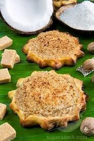 Jamaican Gizzadas - Made from grated coconut, ginger, cinnamon & sugar