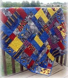 Super hero quilt, batman, superman, spiderman! Awesome pattern with a variation of yellow brick road pattern.