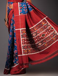 Blue-Maroon Ikat Satin Silk Saree This exquisite Satin saree from Andhra Pradesh has been woven using the resist-dyeing/Ikat technique, which produces the unique patterns adorning the fabric.