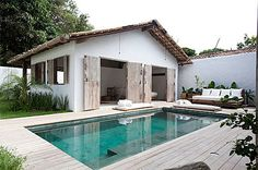 Perfect pool! And I love the low white cushion covered seating around the pool... So Inviting!