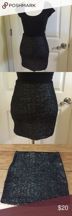 BCBGeneration Skirt BCBGeneration black skirt with a beautiful silver shine. Perfect for a night out or a New Years celebration! Machine Washable. Materials: 96% polyester & 4% spandex. BCBGeneration Skirts Mini