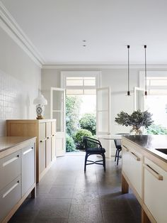 Sydney heritage house kitchen with flagstone floor and French limestone bench tops, burled maple veneer, Viabizzuno pendant lights and Domenico Mori wall tiles from Boffi. Australian Interior Design, Interior Design Awards, Interior Styling, Nordic Interior, French Interior, Discount Interior Doors, Interior Barn Doors, Exterior Doors, Dining Area