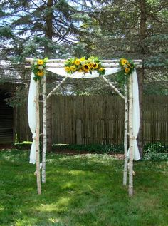 Sunflower weddings, ultra rustic, beutiful canopy in real tree branches. We don't really have birch trees but this recreated in oak would be just as pretty. 10-12 stems sunflowers for the center arrangement, and 3-5 for the each side arrangement, recreated flowers only would start at $120