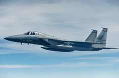 An F-15 Eagle, from the 142nd Fighter Wing, Oregon Air National Guard, flies over northeast Kansas after receiving fuel from a KC-135 Strato...