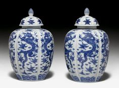 PAIR OF RIBBED UNDERGLAZE BLUE DRAGON VASES AND COVERS IN WANLI-STYLE.    China, around 1930, height 33 cm.
