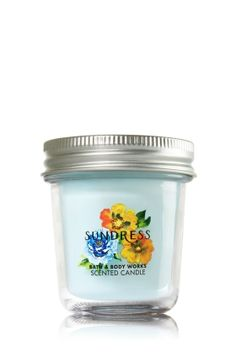 "Sundress - Mini Candle - Bath & Body Works - Made using the highest concentration of fragrance oils and an exclusive blend of vegetable wax and lead-free wicks, this Mini Candle is styled with an adorable mini Mason Jar look. Burns approximately 10-15 hours and measures 2""wide x 1 3/4"" tall."