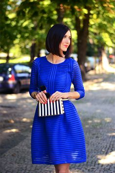 Royal blue dress with texture stripes (I like the red nails with this dress.)