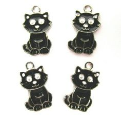 https://www.etsy.com/listing/248161627/halloween-witch-black-cat-charms-black