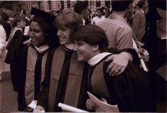 Three Rice University students in academic regalia at commencement ceremony, 1987