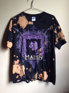 This shirt is a one of a kind, each splattered shirt is different. This one is a great Marilyn Manson tee , all cotton. Splatter bleach and