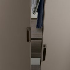 a detail of the new handle integrated in the door in brown aluminium fi nishing with key lock.