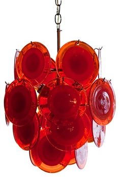 Vintage Italian Murano four-tier chandelier with hand blown Murano glass disks. The chandelier is a vibrant orange which gives it a moder, yet funky vintage vibe.