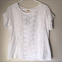 NWT Anthropologie white eyelet blouse Flattering top that is easy and comfy. Back piece a is stretchy cotton that makes this everyday blouse feels like a t-shirt. Pale pink thread lines used for details. Anthropologie Tops Blouses