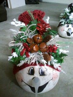 Gourd snowman with lighted nose