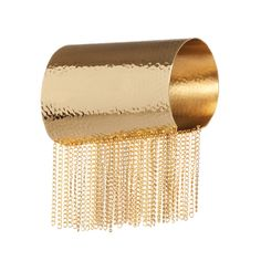 The Greek goddess of the hunt would have loved this piece. Wide hammered gold cuff with gold fringe signals the fierce warrior within.