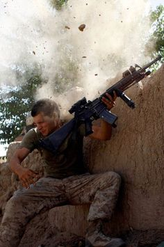 William Olas Bee, a U. Marine from the Marine Expeditionary Unit, has a close call after Taliban fighters opened fire near Garmser in Helmand Province of Afghanistan May in this 2008 file photo. Photo by Goran Tomasevic Military Life, Military History, Military Army, Afghanistan War, War Photography, Us Marines, Marines In Combat, Military Photos, World Trade Center
