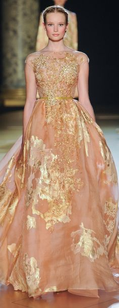 Glamour gown..Elie Saab haute couture gown in pastel pink with gold glimmer embellishments.