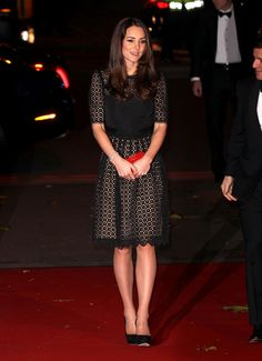 Kate looked lovely in London, wearing an Orla Kiely skirt and MaxMara coat as she received flowers from a young girl. via StyleList