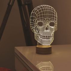 Skull Lamp from MoMA Design Store. Shop more products from MoMA Design Store on Wanelo. Memento Mori, Moma Store, Gravure Laser, Lumiere Led, 3d Studio, Acrylic Sheets, Unique Lighting, Lighting Ideas, Deco Table