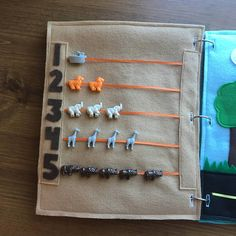 COUNTING 1-5 Quiet Book Page: -Your toddler will have fun learning to count their numbers 1-5 with this animal counting page along with developing their fine motor skills as they move the beads along the ribbon as they count each one. NOTES: Beads and bead colors vary by number and may not always be exactly as pictured. Let me know if you have specific preferences. GENERAL INFO: -Each page is 9x11 inches and has 3 button holes that will fit perfectly in any standard 3-ring binder. This…