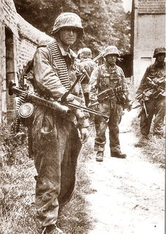 Waffen SS patrol near Utah Beach on D-Day, June 6, 1944. The Waffen SS quickly engaged the Allied troops but were badly outgunned and outnumbered. Nevertheless, they fought a desperate battle suffering irreparable casualties in the process.