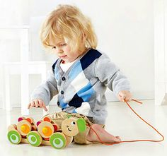 This colorful wooden pull-toy stimulates early walking with smiling sunflowers that turn with every step your toddler takes. Walk-A-Long Caterpillar from Hape. Ages 1 to 3 years. Hot Wheels Storage, Hot Wheels Display, Presents For Boys, Gifts For Kids, Toddler Toys, Kids Toys, Matchbox Car Storage, Caterpillar Toys, Hape Toys