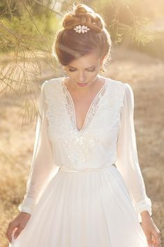 Long sleeved floaty wedding dress. Perfect for a relaxed wedding