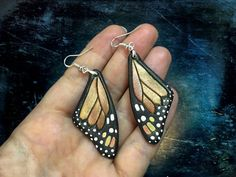 These iridescent tooled leather earrings shaped and painted similar to monarch butterfly wings are meant to enlighten your day and brighten your mood :) These shiny wings would add colors to any grey day! Even those who are allergic to alloys may wear these earrings since theyve got sterling silver hooks. Earrings are 3 (7,5 cm) long and 1 (2,5 cm) wide. Color changes depending on a lighting and angle of view. The parcel will be delivered to you by registered airmail service. Each item I…