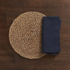 Bali Dark Placemat and Helena Indigo Linen Napkin | Crate and Barrel