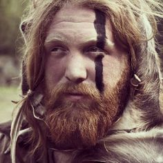A blue line similar to this but thicker and straighter than goes from his forehead down to his ankle (left side of his body). High Fantasy, Medieval Fantasy, Iron Age, Mens Face Paint, Viking Makeup, Vikings, Viking Party, Celtic Warriors, Tribal Warrior