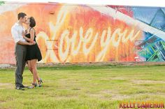 I Love Houston, I Love You | Lauren+Matt's Downtown Engagement Session | Houston Wedding Photographer Kelly Cameron » Kelly Cameron  Urban art abounds in Houston, TX. Engagement session featuring downtown views and great graffiti. Austin based portrait and wedding photographer, Kelly Cameron.  http://kellycameron.net