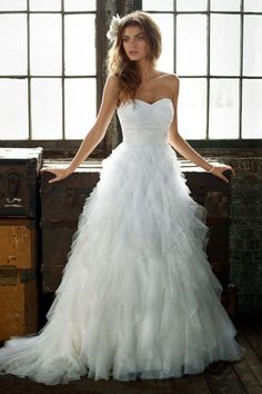 $649 Wedding Dress  http://www.davidsbridal.com/Product_Strapless-Tulle-Ball-Gown-with-Ruffle-Skirt-PK3357_Bridal-Gowns-Shop-By-Trend-Skirt-Drama
