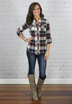 We adore this fitted flannel plaid top! It features colors or navy, rust, faded navy and ivory.