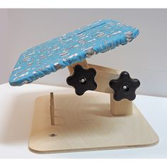 Joyce Haskins has designed a wonderful applique tool! This small, adjustable lap table that provides a place to rest your hands while you stitch. It is made ...