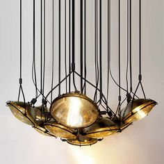 L25 Headlight Chandelier by Commute Design | Please subscribe to my weekly newsletter at upcycledzine.com ! #upcycle