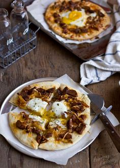 Brunch pizza with egg, sausage and caramelized onions