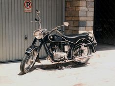 """Beba! BMW R25 motorcycle. Kallipoli, Pireaus, Greece, 1992.  BMW motorcycles, affectionately called in Greece """"bebes"""" (babygirls), are well loved in these parts too. The first ones used were of course those WWII examples left over by the Germans,..."""