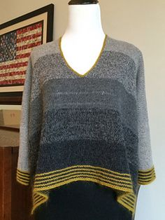 The shape and luscious yarn give this sweater a lovely drape. An ombre color affect is created by double stranding and blending the colors. This sweater has a generous fit.
