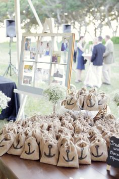 Wedding gift favors: salt water taffy in burlap bags with a black anchor