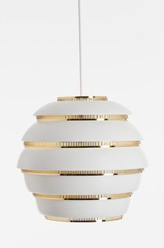 Artek Lighting.  Brass and white. This is what I want for the dining room.