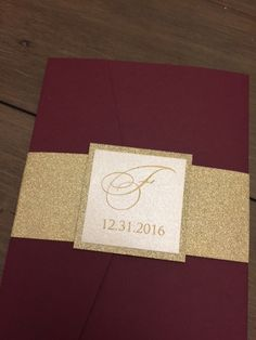 THIS LISTING IS FOR A SAMPLE ONLY. Samples are made with generic information inside. Pricing for 100 invitations with RSVP set starts at 535.00 plus shipping Need less or more please message me for a custom quote. :::::::: ♥♥ THE INVITATION ♥♥ :::::::: The invitation shown is our Burgundy Pocket invitation suite set inside a stunning Burgundy with a gold glitter base layer. The invitation pocket is wrapped in a gold glitter belly band. Invitation shown is printed on shimmer off white ecru…