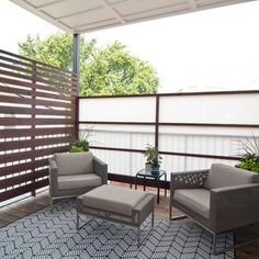 Love this outdoor seating area...frosted glass wall provides privacy while still allowing light to enter into the space!  www.franksglass.com