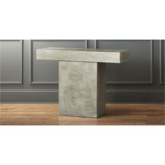 Shop fuze grey console table.   Aggregate of marble, granite, stone and natural fibers cements a sculptural, floating cantilever that reminds us of Wright's Fallingwater.