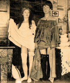 Two Alaskan beauties show off their wares for the cameras. Women heading for Dawson City or Ketchikan made perilous journeys to Alaska, often traveling for months to reach their destinations. The trip was worth it, for those girls of the mining camps earned better money.