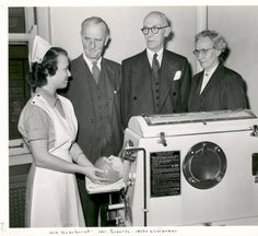 Infant respirator demonstration at St. Louis Children's Hospital. Early 1950s. A baby iron lung for the victims of polio.