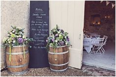Bordeaux flowers on wine barrels | Image by Claire Penn Photography