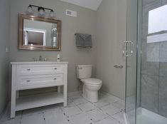Contemporary 3/4 Bathroom with Limestone counters, High ceiling, Console Sink, Austell Single Bath Vanity, specialty door