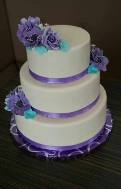 Wedding cake 60th anniversary purple and blue sugar flowers ivory base 3 tiered. Made by #createdbymanon : Facebook.com/createdbymanon