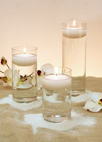 """Put your creativity to work and create a unique, one-of-a-kind look for your wedding. By filling each vase with your own decorations, flowers, candles, sand, candy, etc. the possibilities are endless. This set can be used to enhance any ceremony alter, reception tables, or be used to add a decorative touch to your ceremony and reception venues. Set includes 1 - 10"""" vase and 2 - 7.5"""" vases.  #DBBridalStyle"""