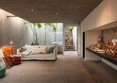 Concrete art studio by Felipe Assadi nestles into rocky hillside